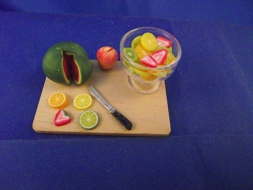 Broad with Melon Apple Fruit slices Knife Fruit Cocktail