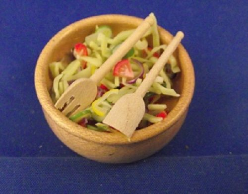 White bowl with chopped salad and wooden severs