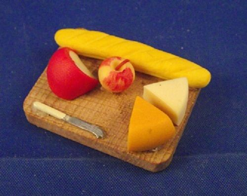 Wooden broad French stick chesses an apple and a knife